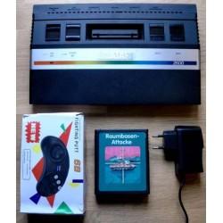 Atari 2600: Konsoll med joypad og spill
